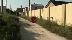 Barrier gate and STOP sign zoom in Stock Footage