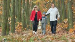 Happy family with child teen boy , healthy autumn walk, health Stock Footage