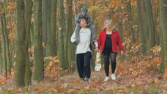 Healthy happy family with child teen boy, schoolboy, healthy autumn walk   - stock footage