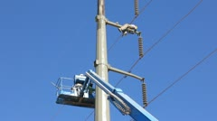 Dirty and dangerous jobs - painting high power poles - laying on the span Stock Footage