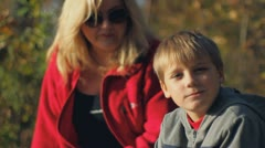 Healthy active outdoor recreation, mother and son child schoolboy teen health  - stock footage