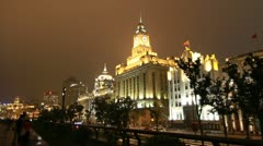 The Bund traffic and old style buildings, architecture in Shanghai, China Stock Footage
