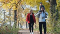 Stock Video Footage of active outdoor recreation, happpy family, parents with child, father and mother