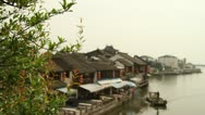 Traditional house and boat in the river in Zhujiajiao, China Stock Footage