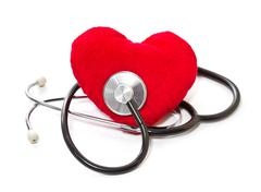 Medical stethoscope and plush heart on a white background Stock Photos