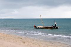 fishing boat along the coast - stock photo