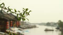 Pull focus shot of old house by the river in Zhujiajiao, China Stock Footage