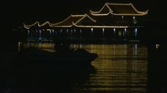 Boats on Xuanwu Lake by night, Nanjing, China Stock Footage