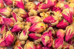 background of heap dried rosebuds - stock photo