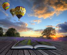 hot air balloons lavender landscape magic book pages - stock illustration
