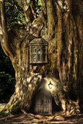 Stock Illustration of fantasy fairytale miniature house in tree in forest