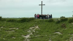 Zoom out from tour group at memorial cross to reveal Lochngar Crater The Somme. Stock Footage