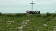 Stock Video Footage of Zoom out from tour group at memorial cross to reveal Lochngar Crater The Somme.