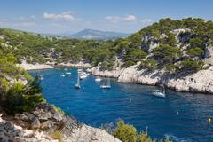 Moored boats in the calanques of port pin in cassis Stock Photos