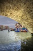 Low view through rialto bridge along grand canal venice italy Stock Photos