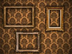 gilded vintage frames on damask wallpaper background - stock photo
