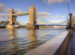 london's tower bridge bathed in sunlight on a bright summer's day - stock photo