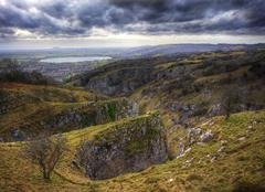 Stunning landscape across top of ancient mountain gorge Stock Photos