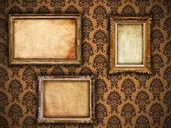 Gilded vintage frames on damask wallpaper background with grunge retro paper Stock Photos