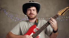 Man plying song Stock Footage