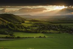 Stock Photo of stunning summer sunset over countryside escarpment landscape