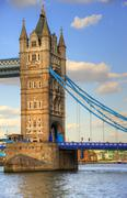 Detail of one tower of london's tower bridge bathed in sunlight on a bright s Stock Photos
