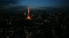Aerial View of Tokyo Tower in Japan, Zeppelin at dusk over Tokyo Skyline - stock footage