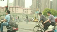 Busy traffic with moped and bicycle in Shanghai, China Stock Footage