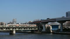 Regional Train, Tokyo, Japan, Bridge over Sumida River, Highway Traffic, Railway Stock Footage