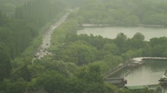Pan shot to the Golden Dragon Boat Restaurant in West Lake Stock Footage