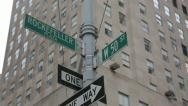 Stock Video Footage of Rockefeller Plaza and W50th Street Sign with Bird