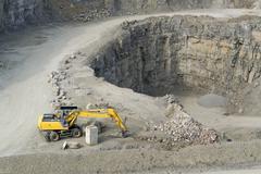 Yellow quarry digger Stock Photos