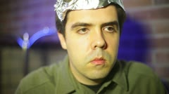Crazy guy drinking tea drink tin foil hat Stock Footage