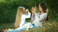 Mother and Child Playing Outdoors Stock Footage