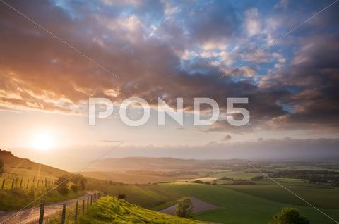 Stock photo of beautiful english countryside landscape over rolling hills