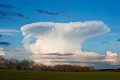 Stunning natural mushroom cloud formation in blue sky Stock Photos
