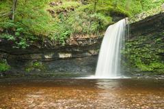 beautiful woodland stream and waterfall in summer - stock photo