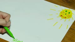 Child's hand draws a summer landscape (time lapse). Stock Footage