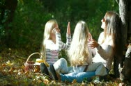 Happy Mother and Daughters Playing Outdoors Stock Footage