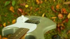 Guitar walking traveling musician music rock autumn Stock Footage