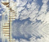 spiral stairway to heaven glows against blue sky and reflection in water - stock illustration