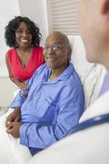 Senior african american man patient in hospital bed Stock Photos
