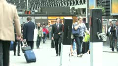 Train station and commuters Stock Footage