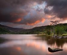 beautiful sunrise over llyn gwynant in snowdonia national park - stock photo