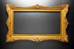 Elegant golden frame on dark grey Stock Photos