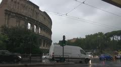 Urban traffic near the coliseum. Rain in Rome Stock Footage