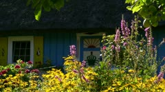 Traditional Thatched-Roof House With Beautiful Garden - Baltic Sea, Germany Stock Footage