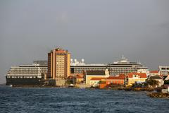 Cruiseship at Willemstad skyline Stock Photos