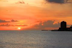 sunset at willemstad harbor in curacao - stock photo