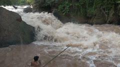 Laos makeong river rapids fisherman Stock Footage